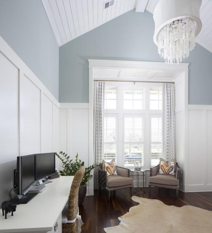 Beautiful white wall paneling with timber vaulted ceiling.  Love the wall paint colour!