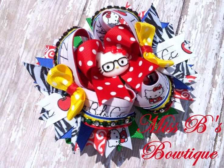 My Daughters Back to school bow Hello Kitty Inspired!!! www.facebook.com/missbsbowtique05  New things added Daily!!