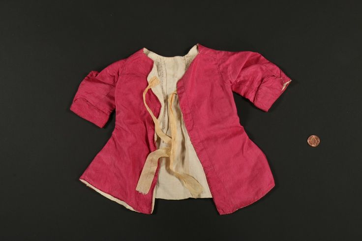 Infant's jacket, late 18th century. Pale pink silk, yellow silk ribbons, linen lining.