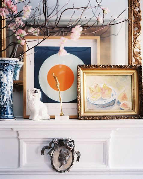 January February 2013 Issue Photo - Framed art and a vase of flowering branches on a white mantel