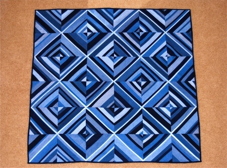 "Love this quilt using old denim jeans! Climbing the Walls by Lynne Miller-Deist.  (Looks like the strips are all different widths - except maybe the one down the center of each block - which then goes on to define the larger ""squares"")"