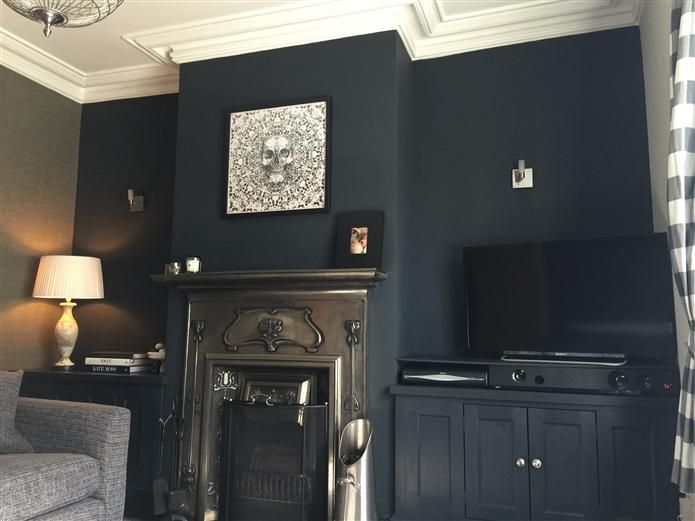 Farrowandball Railings fireplace feature wall. built-ins on either side.