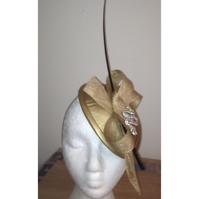 Gold leatherette and sinnamay hat with diamanté snake trim