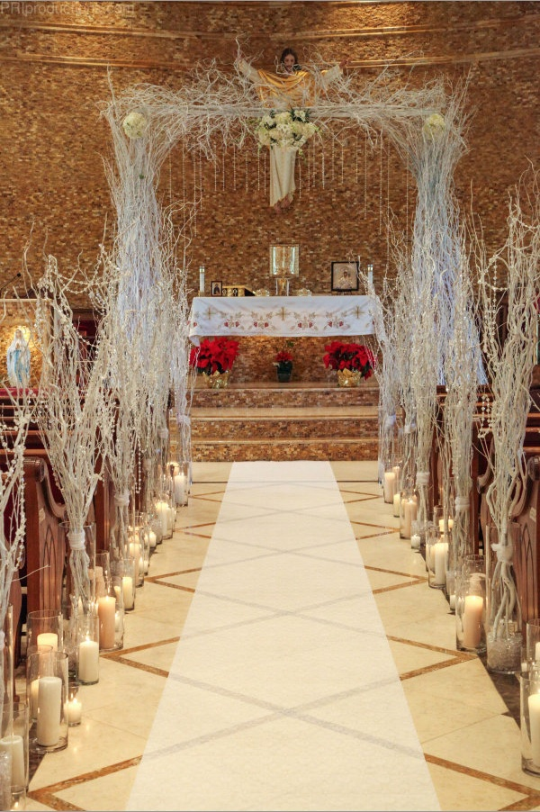 church wedding decorations candles%0A White branches and candles lining the aisle leading up to arch