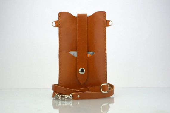 The leather iPhone 6s Plus Bag, iPhone 6s Plus case with crossbody strap is made from gorgeous Italian vegetable tanned leather and the strap is adjustable so you can wear it as a shoulder bag or tote, across your chest messenger-style or remove the strap completely and use the case on its own. The iPhone and card holder are secured with a strap that snaps in front. SIZE & DIMENSIONS • Regular Size Fits for naked iPhone 6s Plus (5.5 inches) / iPhone 6 Plus (5.5 inches) without other…