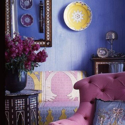 This beautiful living room is definitely magical Moroccan space. The deep blue and purple palette is accented with gold and pearl inlay accents.