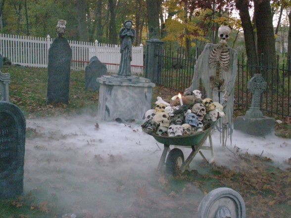Morton Manor, Our Spooky House on Halloween.  We have a graveyard, filled with fog & otherworldly creatures in the front yard., Skeleton in Graveyard, Indoor and Outdoor Decorations
