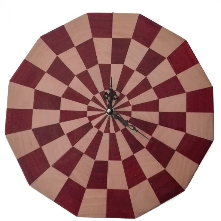 Twelve-sided x4 wall clock. Dodecagonal wall clock inlaid by hand, composed of 48 pieces of various wood types.