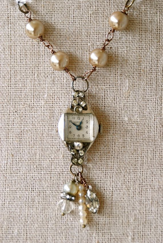 This is an 18 antique brass necklace.Vintage faux glass pearls with vintage crystal chandelier prisms are linked to the necklace. It features an