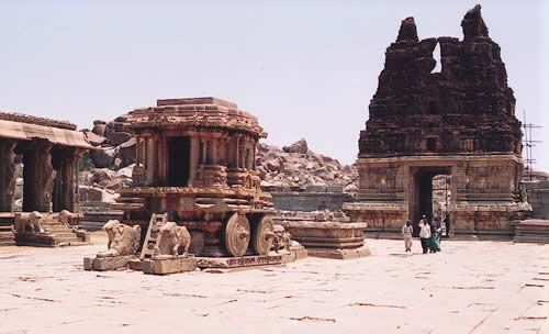 Vijayanagar, the capital of one of the largest Hindu empires ever, was founded by Sangama dynasty princes Harihara and Bukka in 1336. Its power peaked under Krishnadevaraya (1509-29), when it controlled nearly the whole of the peninsula south of the Krishna and Tungabhadra rivers. Comparable to Delhi in the 14th century, the city, with an estimated population of half a million, covered 33 sq km and was surrounded by several concentric lines of fortification. Its wealth derived from the…