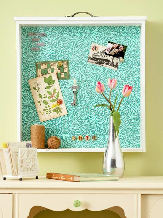 Turn an old drawer into a bulletin board/shelf combo.