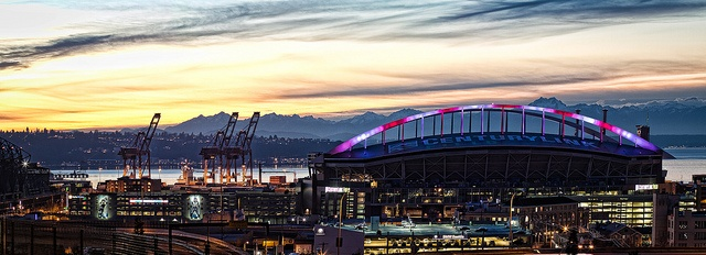 Centurylink Field with its lights colored like candy canes for Christmas