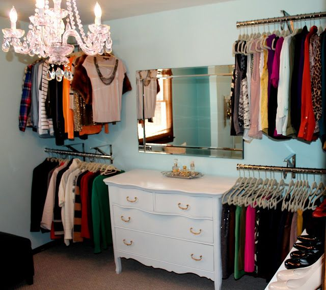 Turn any space into much needed closet space...a few rods on the walls, some floating shelves and I'm in business!