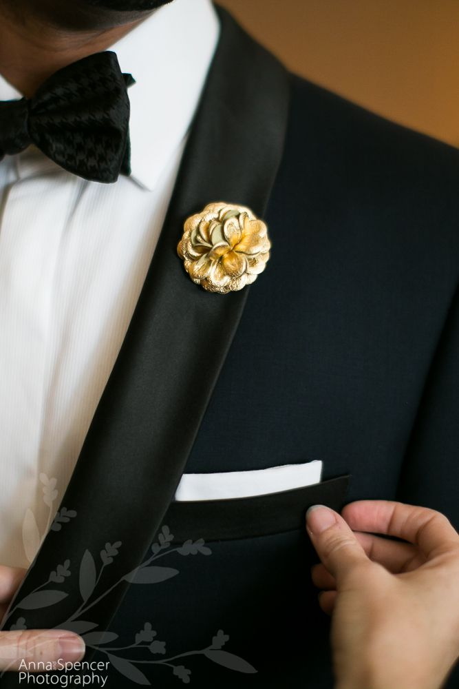 Anna and Spencer Photography , Atlanta Wedding Photographers . Groom getting ready for his wedding . Black tie , gold floral lapel pin , pocket square .