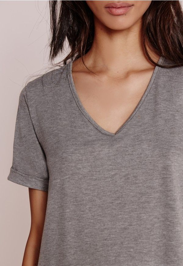 """Good things come in small packages. Shop our Missguided Petite range, for babes 5""""3 and under.   Update your wardrobe staples with this chic tall V neck boyfriend t-shirt in on point grey marl. Its loose fit, soft jersey fabric and V ne..."""