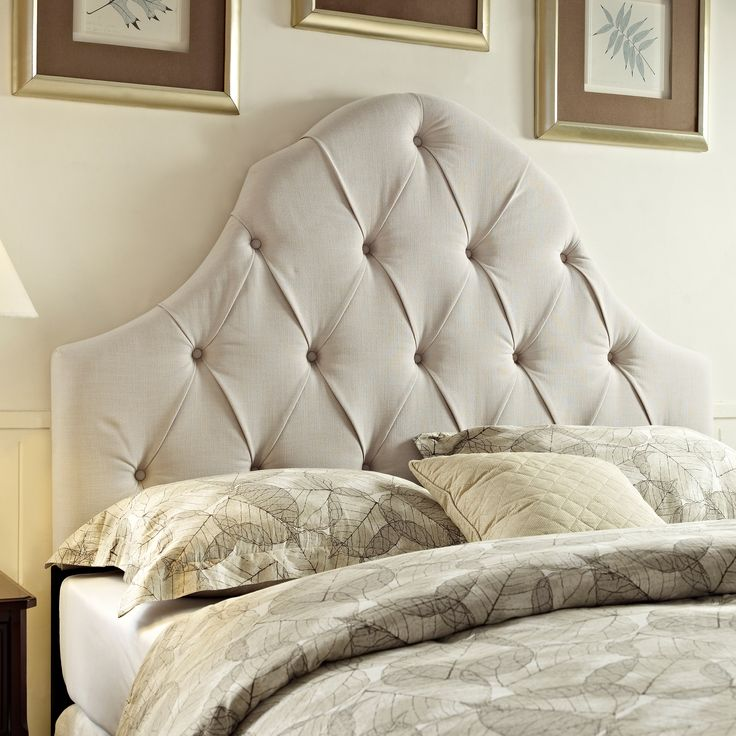 Tufted ivory king/ California king size upholstered headboard is handcrafted using time-honored Old World techniques.  This plush tufted upholstered headboard is generously padded and can be used for both king and California king size beds