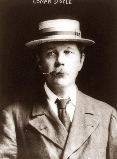 Arthur Conan Doyle, 1913  -very much the picture of the Edwardian gent with straw boater and tie. Oh and that moustache.