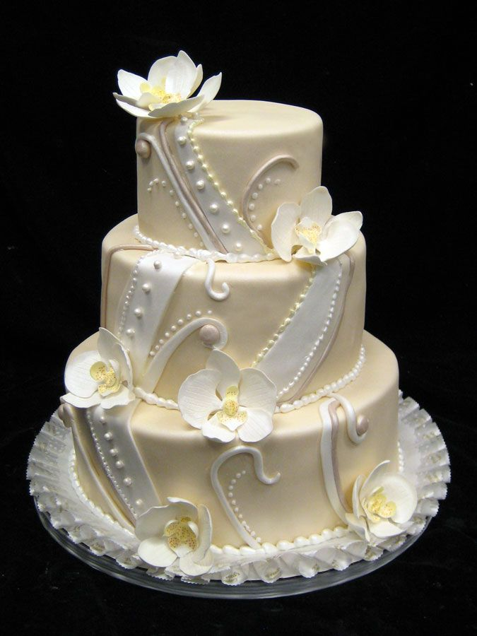 Pale yellow cake with white trim and flowers