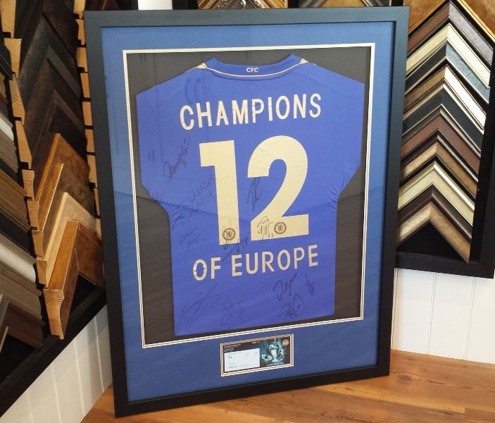 We framed this signed Chelsea Football Club shirt and ticket.