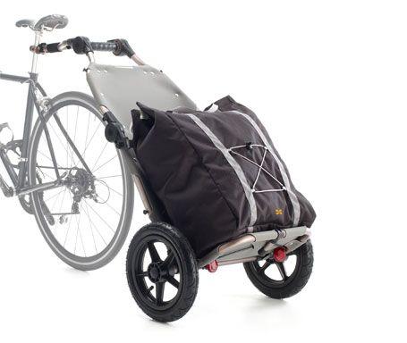 Burley Travoy fietskar. Opvouwbaar, wielen kunnen eraf en in de tas. Ideaal voor vakantie met de trein en grote boodschappen.