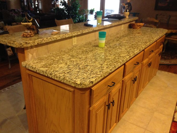 raised kitchen island island with raised seating area surface facing the living 14666