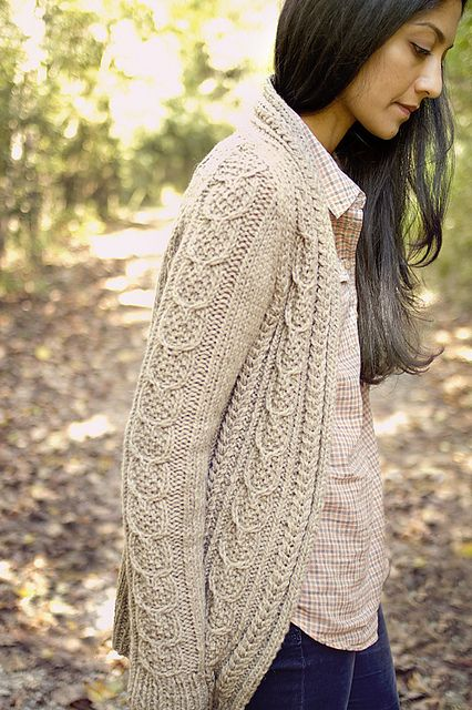Pretty cabled cardi called Aidez. Pattern available for free :). It's on Ravelry.
