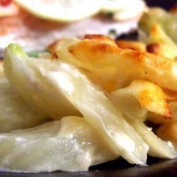 Gebakken venkel met parmezaanse kaas  Gemaakt met gegrilde kip en patatjes, maar dat was zelf overbodig...Zaaaaalig die smaken
