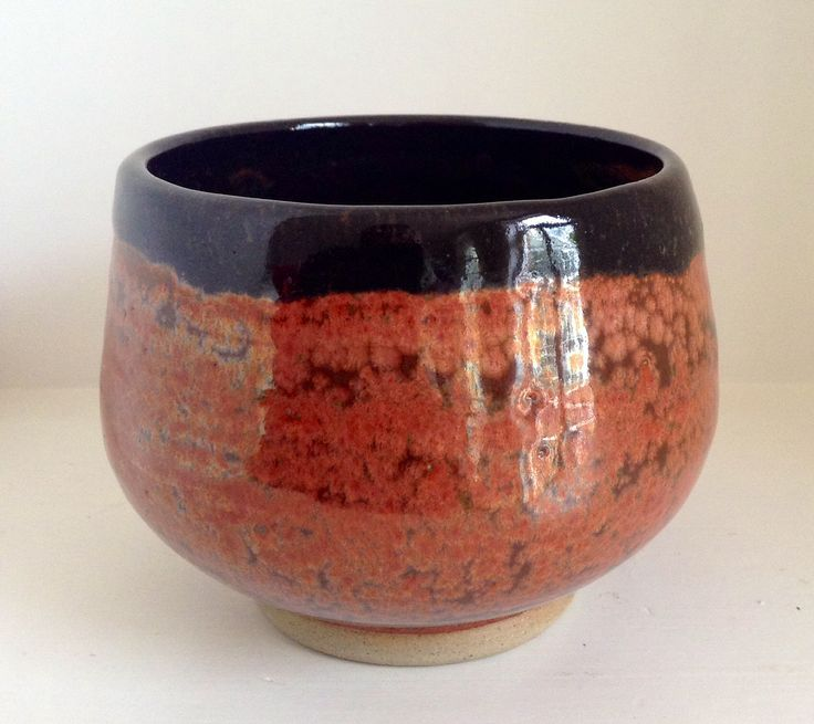 Tea bowl, iron red and black cone 6 glazes. Annie Jennings.