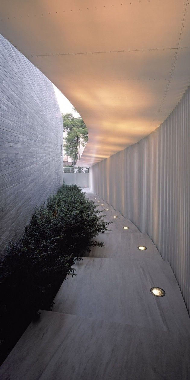 Psychiko House by Divercity Architects great way to use light by reflecting it outdoors on overhang