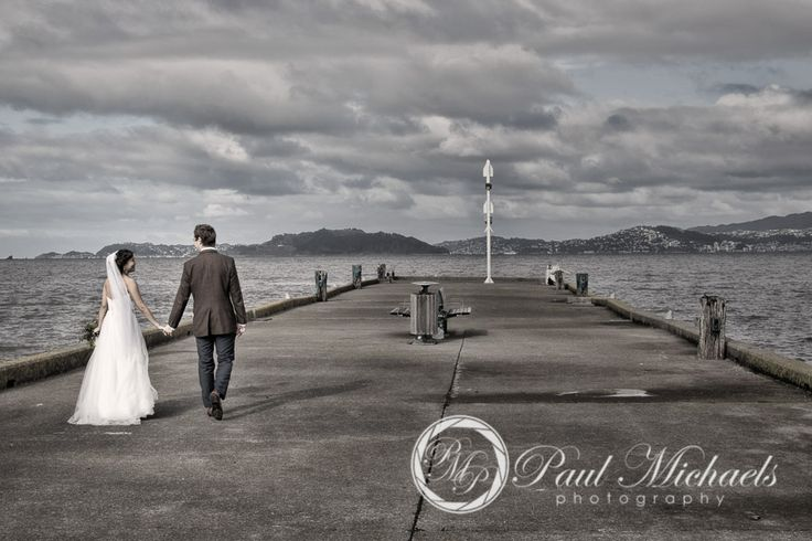 Wedding couple on Petone wharf. New Zealand #wedding #photography. PaulMichaels of Wellington http://www.paulmichaels.co.nz/