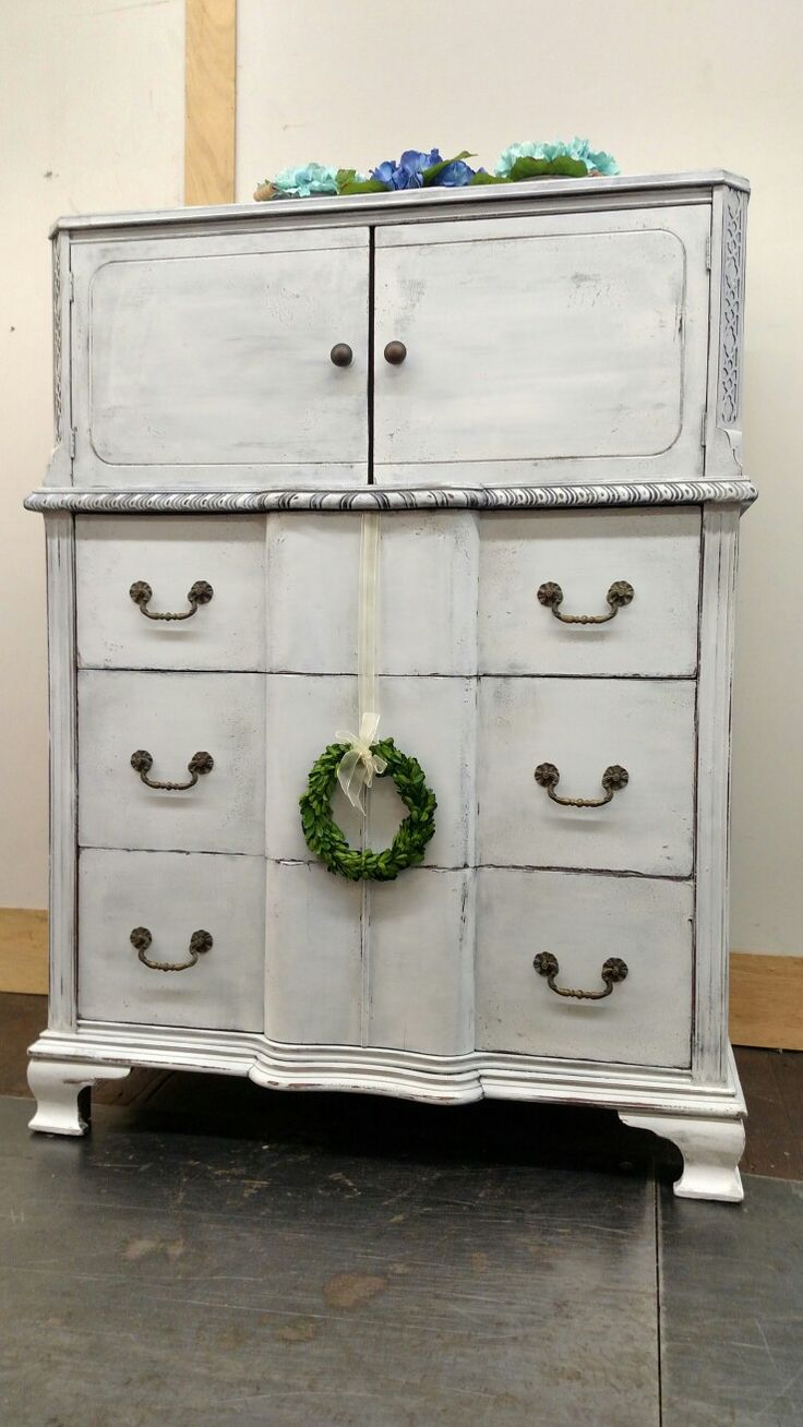 Bureau painted in layers of hurricane gray mixed with PoP as base and Fluff by Dixie Belle Paint. Painted bureau