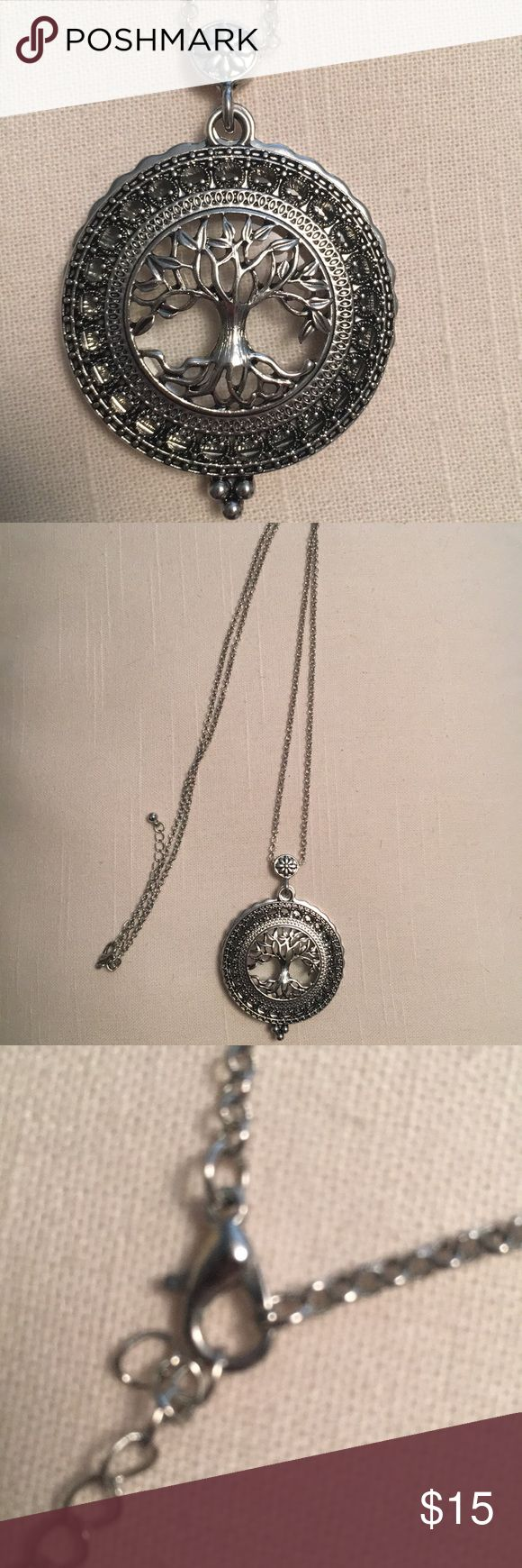 Long Tree of Life Necklace 16 inches long with a 2 inch extender. Has a magnifying glass behind pendant. Jewelry Necklaces