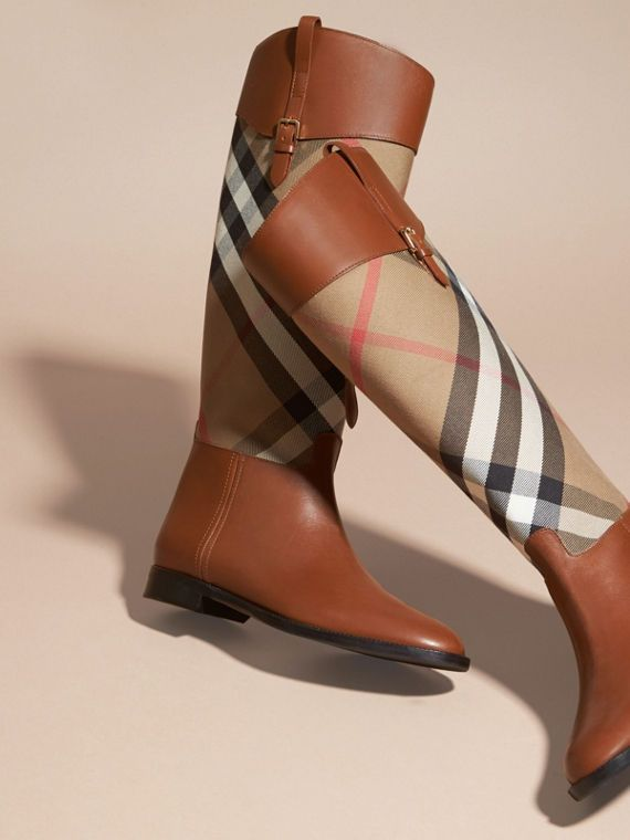 Rich leather and English-woven House check riding boots from Burberry.