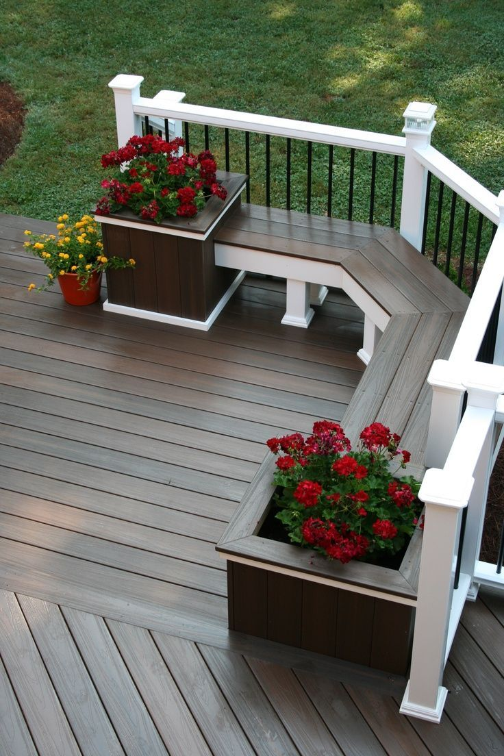 Nicely built deck bench with rail and planters at either end of the bench seating.
