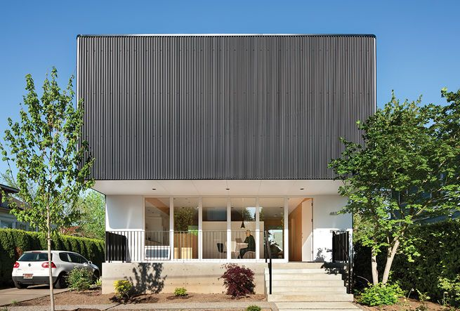 Architect Ben Waechter wrapped the upper floor of Nick Oakley's house in inexpensive black corrugated steel. By rounding the corners, Waechter avoided unsightly trim at the edges.  Courtesy of: Lara Swimmer