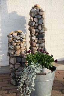 Do this with that old cage birdfeeder--maybe paint some of the rocks in bright colors for a pop?