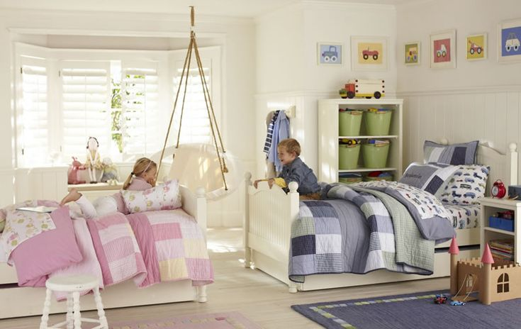 Shared boy & girl room:  the same patterned comforters - one in blue & one in pink