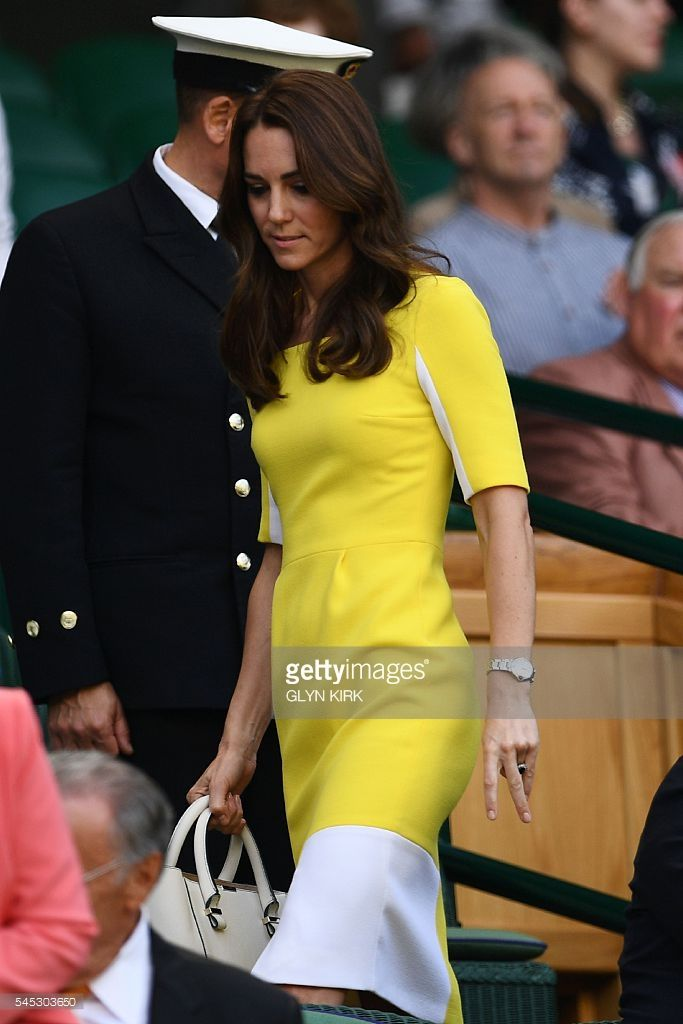 Britain's Catherine, Duchess of Cambridge (C) takes her seat in the royal box on centre court to watch the women's semi-final match between US player Serena Williams and Russia's Elena Vesnina on the eleventh day of the 2016 Wimbledon Championships at The All England Lawn Tennis Club in Wimbledon, southwest London, on July 7, 2016. / AFP / GLYN KIRK / RESTRICTED TO EDITORIAL USE        (Photo credit should read GLYN KIRK/AFP/Getty Images)