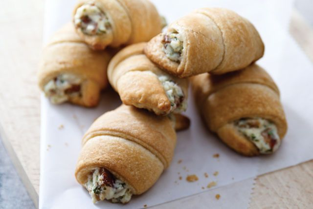 """Savory dip meets crescent roll for a whole new take on hot appetizers. These toasty bites will go faster than you can say, """"They have bacon."""""""