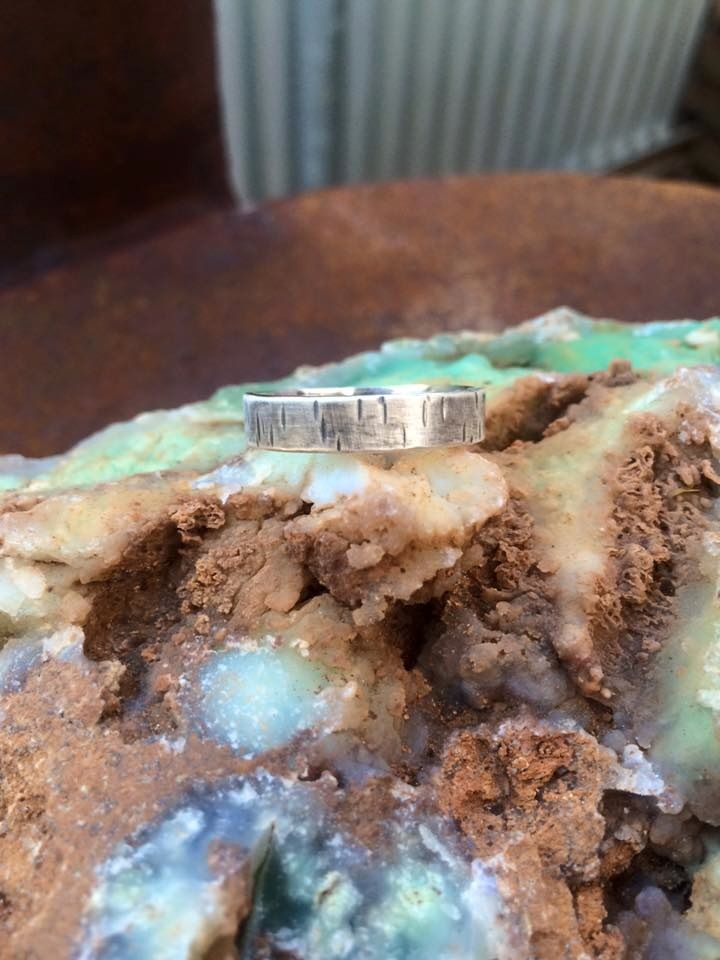 Distressed woodland band, this has been designed as a mens ring,but can be unisex ring. textured hammered distressed matte finish oxidised, polished inside ring.made from 5mm wide band 925 recycled sterling silver