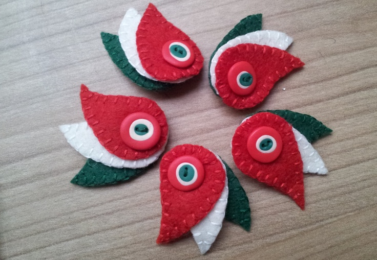 Kokárda - hand embroidered felt brooch with a polymer clay button. $10.00, via Etsy.