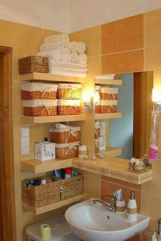 Bathroom Storage Idea.... Baskets and shelves.