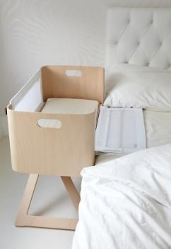 NCT Bednest bedside crib has variable height adjustment.