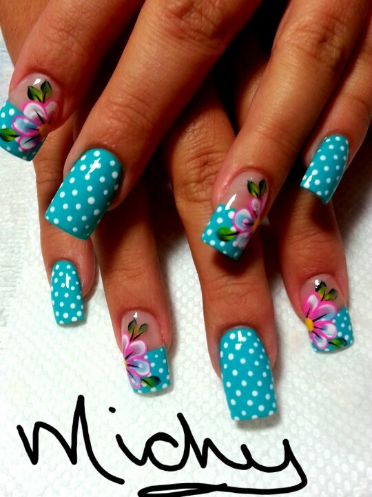 Turquoise nail art with polka dots and floral accents