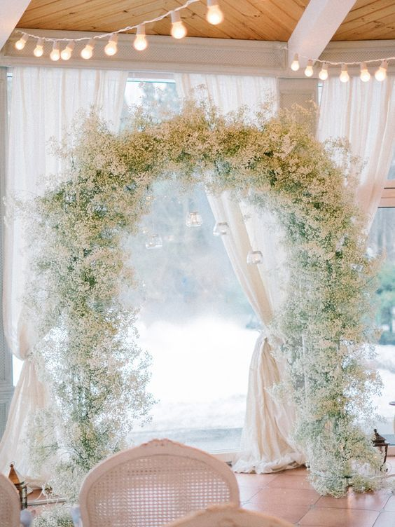 Baby's Breath arch for Winter wedding ceremony decoration /  / http://www.himisspuff.com/rustic-babys-breath-wedding-ideas/2/