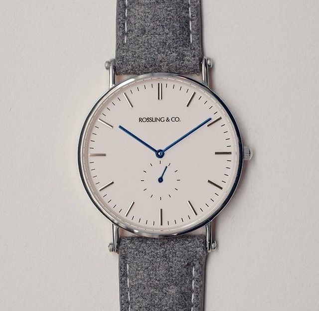 Our Classic 40mm Glencoe watch featuring an ultra-thin case, Swiss quartz movement and a unique tweed strap. Minimalist white dial with our signature blue hands and silver case. Dark grey tweed strap