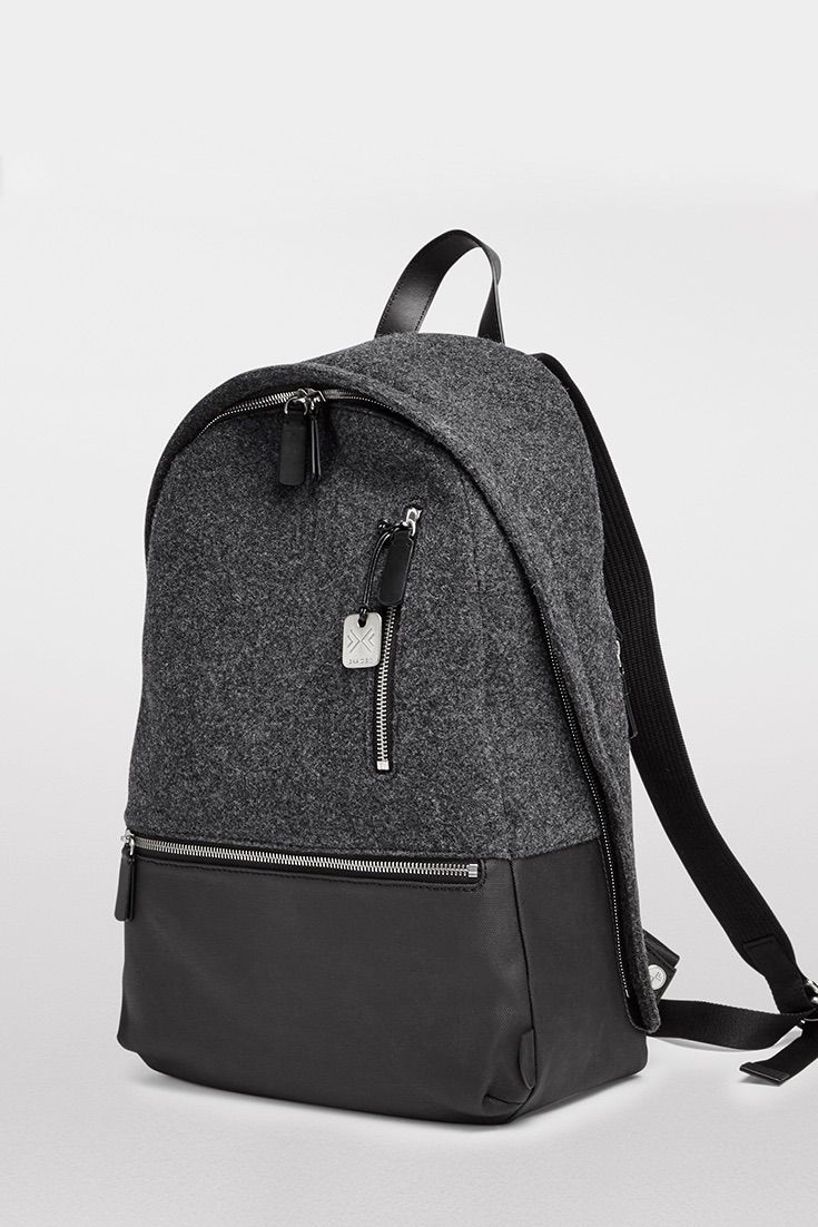 Our Krøyer Backpack is designed to make your journey as anticipated as the destination. In addition to an updated laptop sleeve and pen holders, the inside pocket now features two mesh pockets for all your cords. So you can listen to music or catch up on calls while you commute, our signature zip-through pocket allows space for earbuds to extend through even when zipped. With an additional vertical zip pocket and extended horizontal pocket, the front is even more functional.