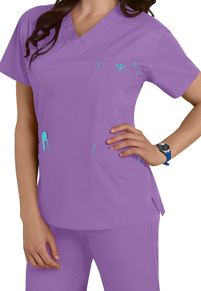 Comfort and durability are the trademarks of this classic v-neck scrub top from Med Couture! The EZ Flex top is made of a stretch material that will keep you comfortable all shift long. Includes roomy pockets for your accessory needs.