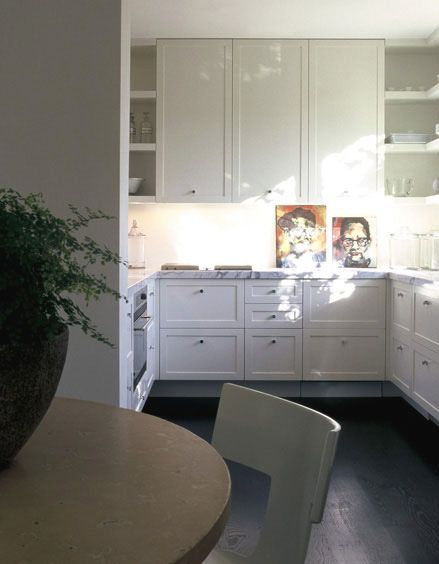 I fell in love with this kitchen I saw in a magazine. I had this picture in a file for years and it was my inspiration to redo my kitchen just like it. I repainted my old cabinets, added the same modern drawer pulls, and used the same carrera marble, et viola a very similar modern kitchen.