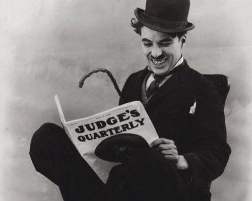 Charlie Chaplin reading a book. Pin if you like the photo! :) #reading #books #charliechaplin